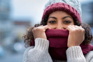 Ways to prevent asthma attacks in the winter include covering your nose and mouth while outdoors.